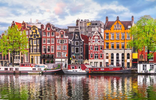 Amsterdam,Netherlands,Dancing,Houses,Over,River,Amstel,Landmark,In,Old