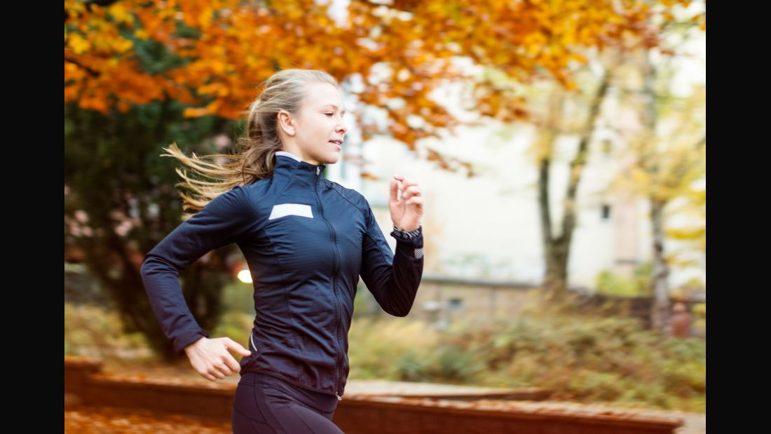 Healthy young female running in the park