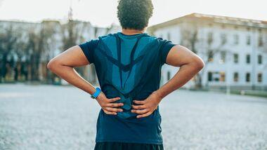 Läufer mit Rückenschmerzen