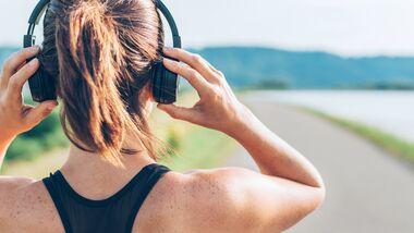 Läuferin mit Kopfhörer