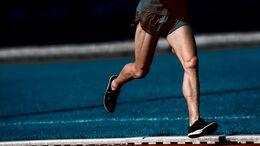 Low Section Of Man Running Marathon