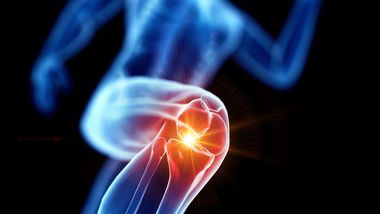Runner with knee pain, conceptual illustration