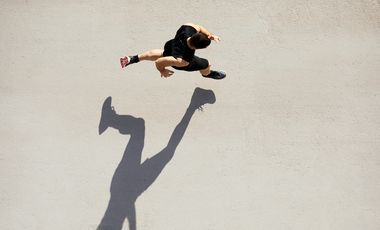Sprinter seen from above with shadow and copy space.